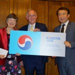 Enid Humfrey receives the winning ticket from Korean Air representative Roy  Jongrae Kim